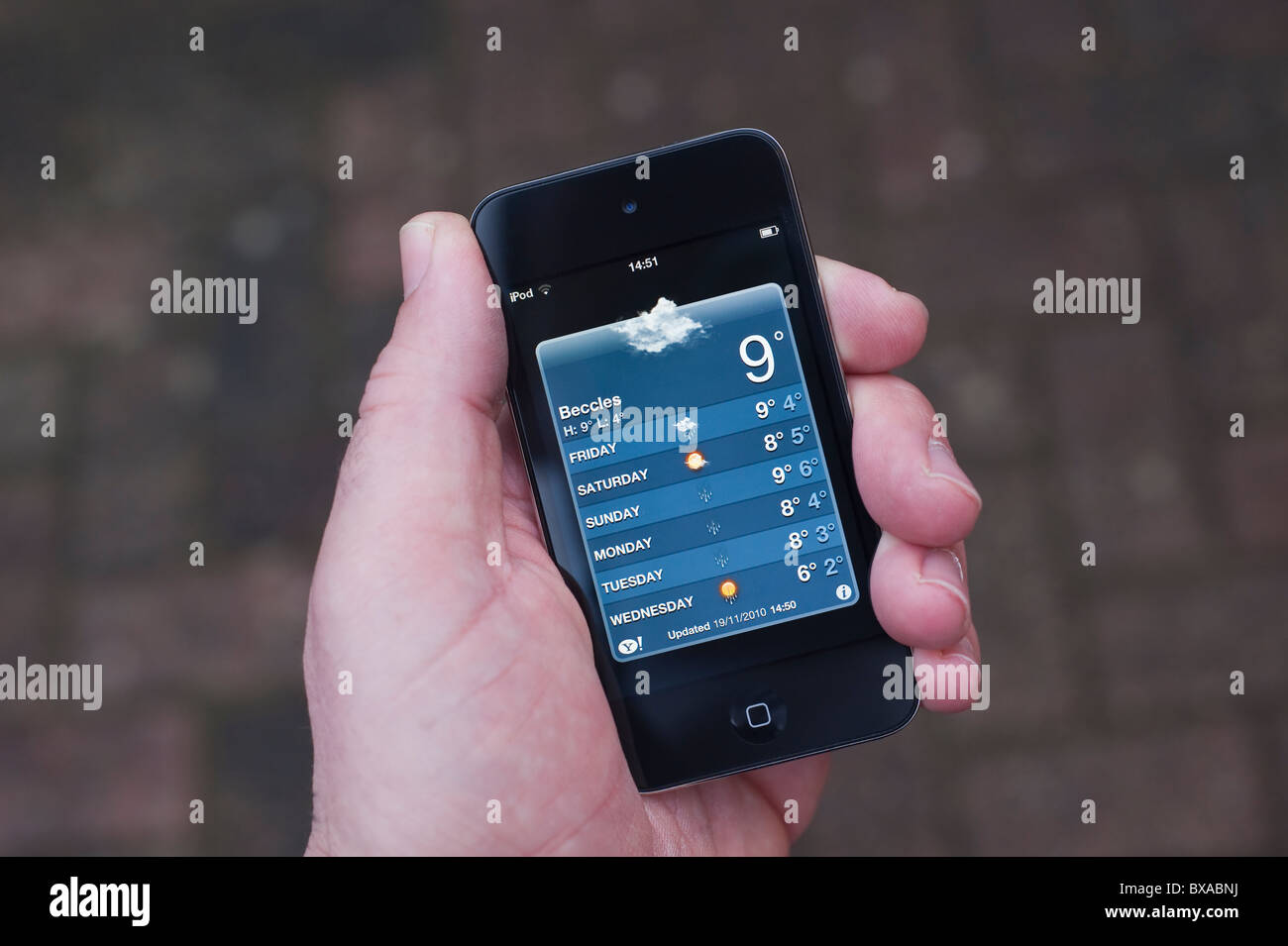 The new Apple Ipod touch 4th generation 4G 32gb media player with internet connection showing weather forecast - Stock Image