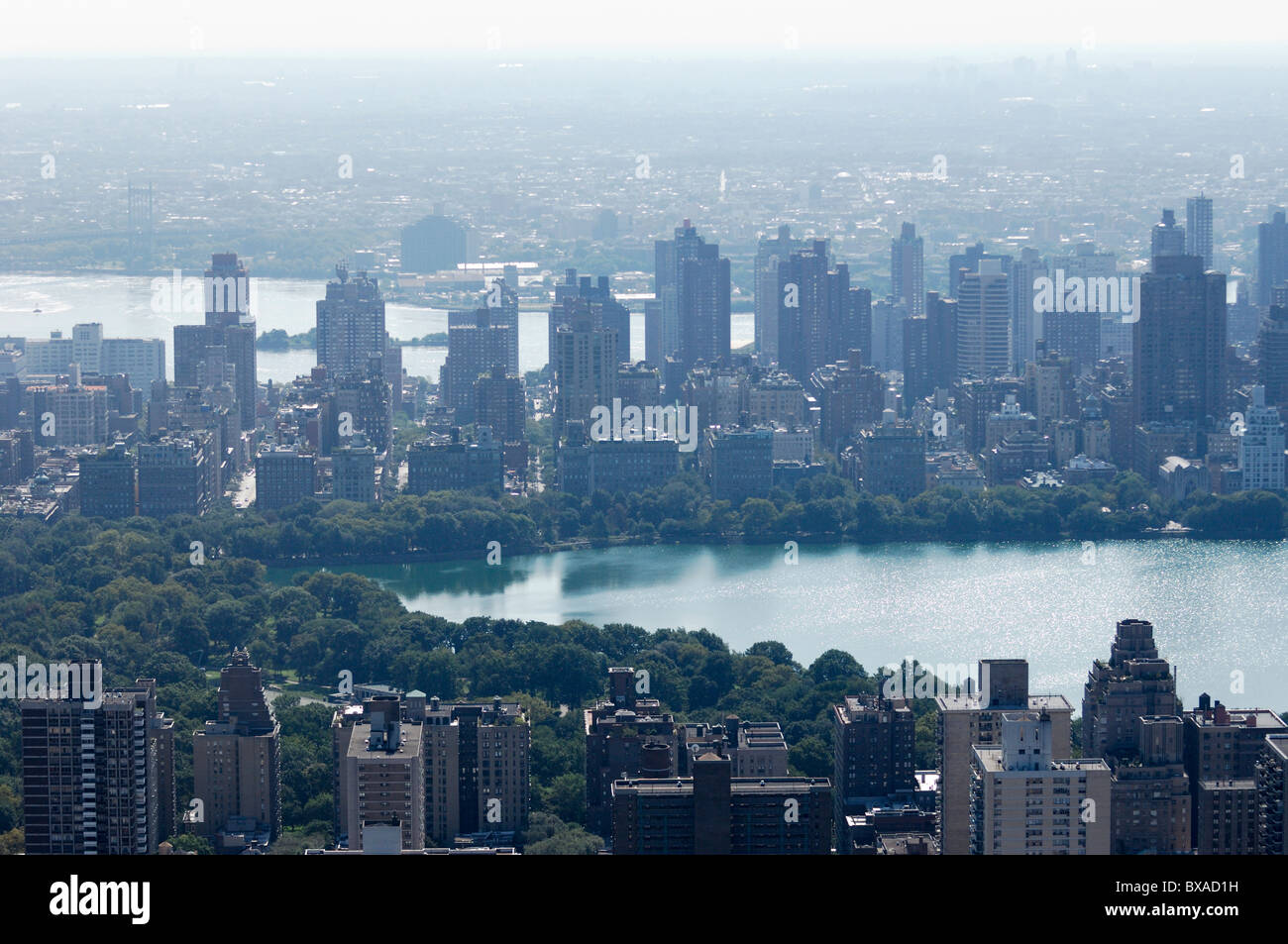 Aerial of Upper West/East side, and reservoir J Kennedy in Central park, during heatwave in hot summer, Manhattan, - Stock Image