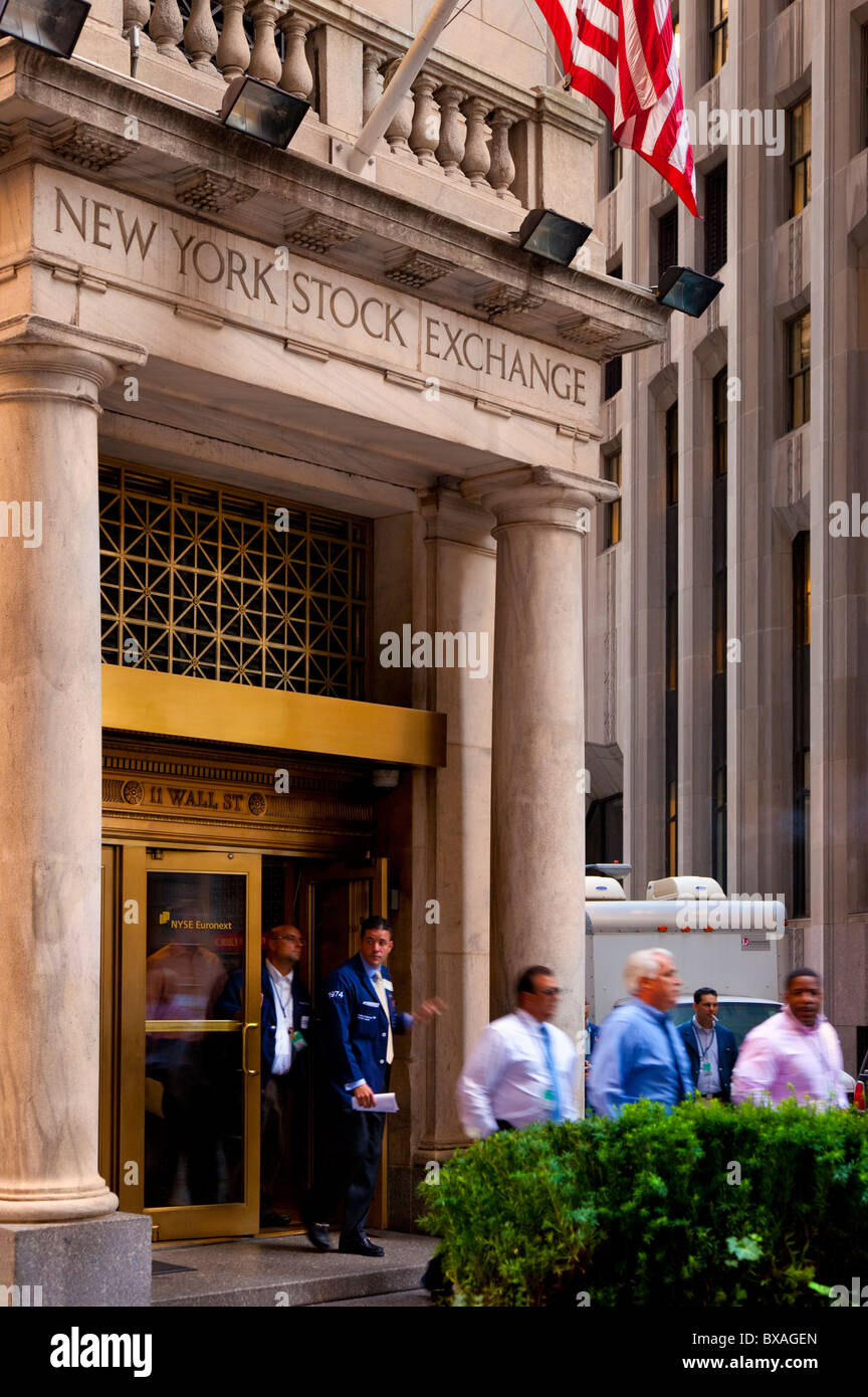 Traders leaving the New York Stock Exchange after a down day on the market, New York City USA - Stock Image