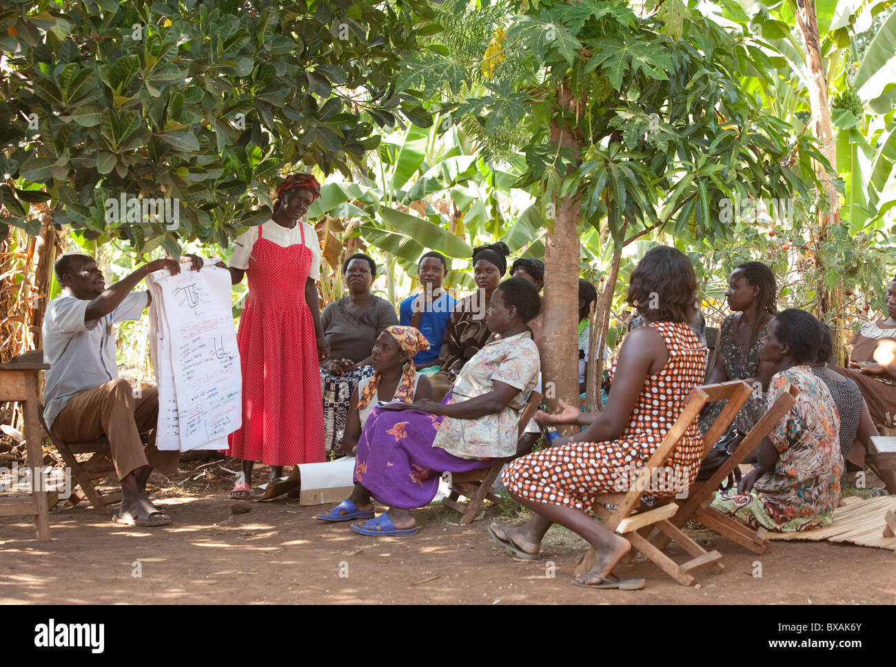 Villagers attend a community meeting in Buwanyanga Village - Sironko, Eastern Uganda, East Africa. - Stock Image