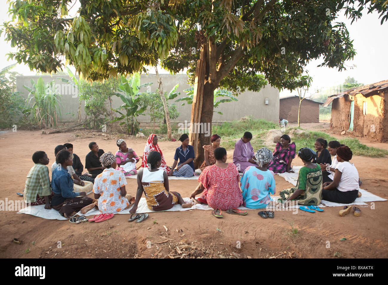 Women attend a community meeting in Nkono Village, a village outside Iganga town, Eastern Uganda, East Africa. Stock Photo