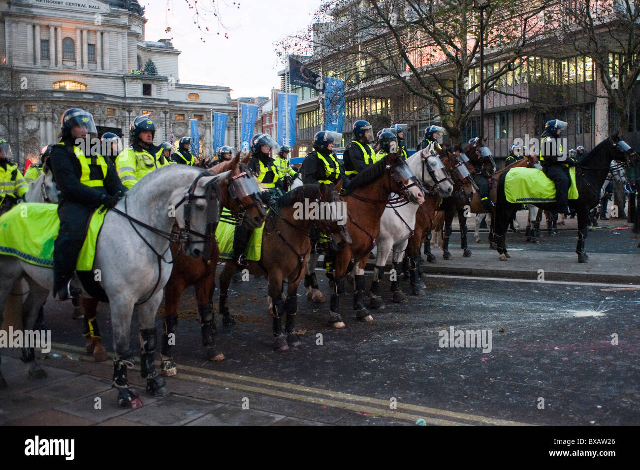 Metropolitan police horses on duty during student riots in London in 2010. - Stock Image