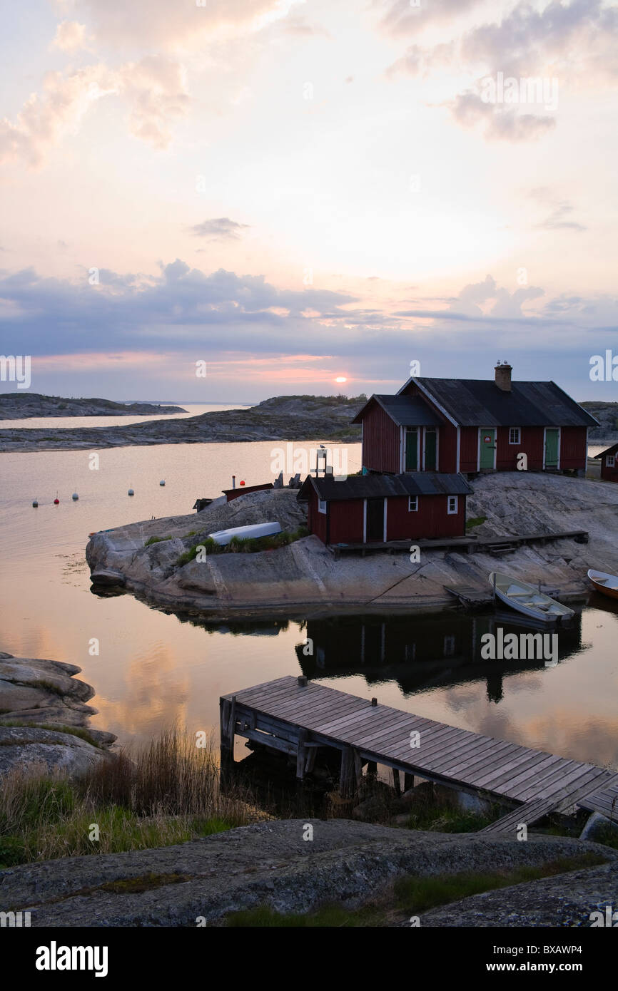 Cottages on rock by sea - Stock Image