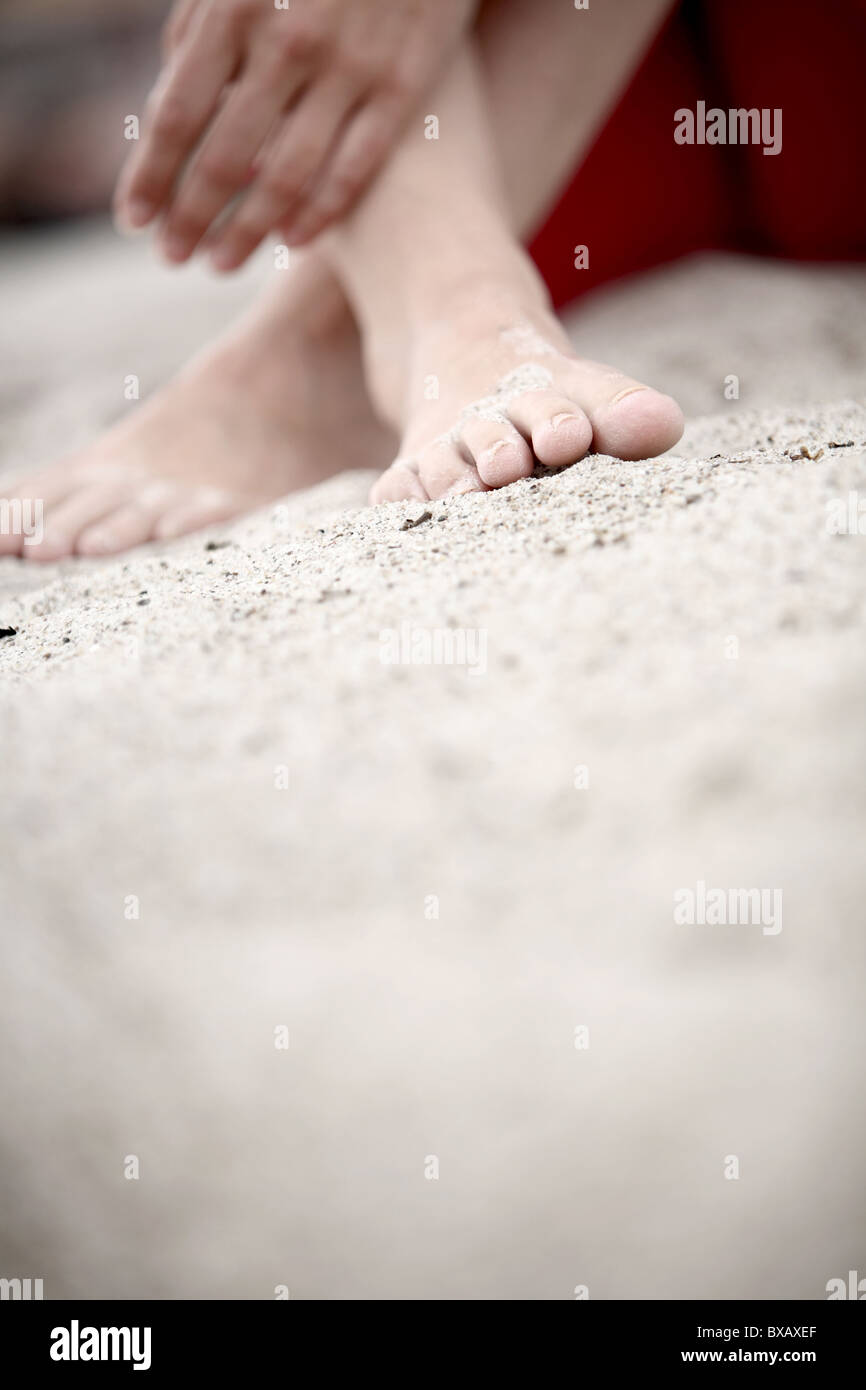 Feet in the sand - Stock Image