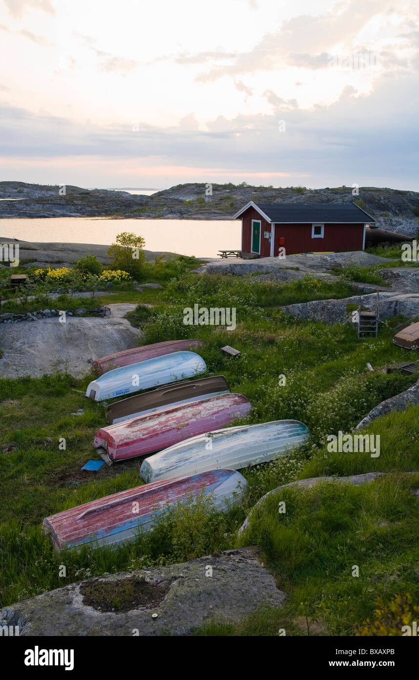 Row of old boats lying on grass - Stock Image
