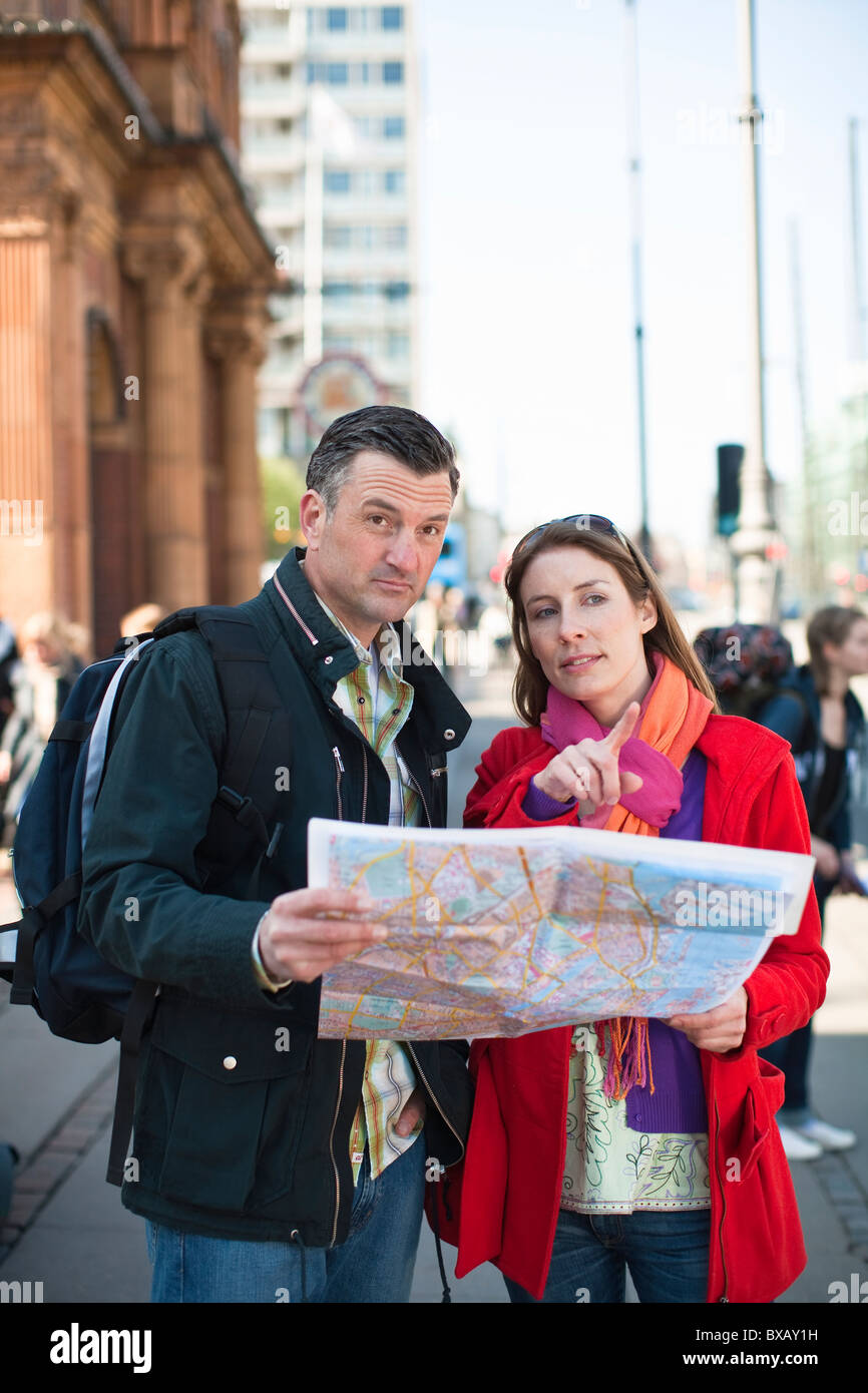 Couple with map sightseeing in city Stock Photo