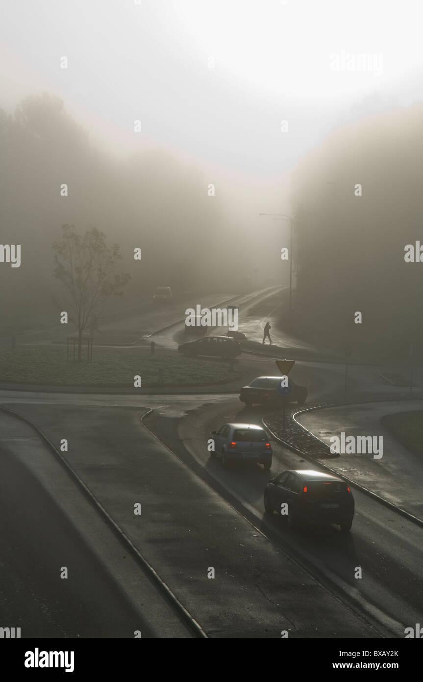 Traffic in morning fog - Stock Image