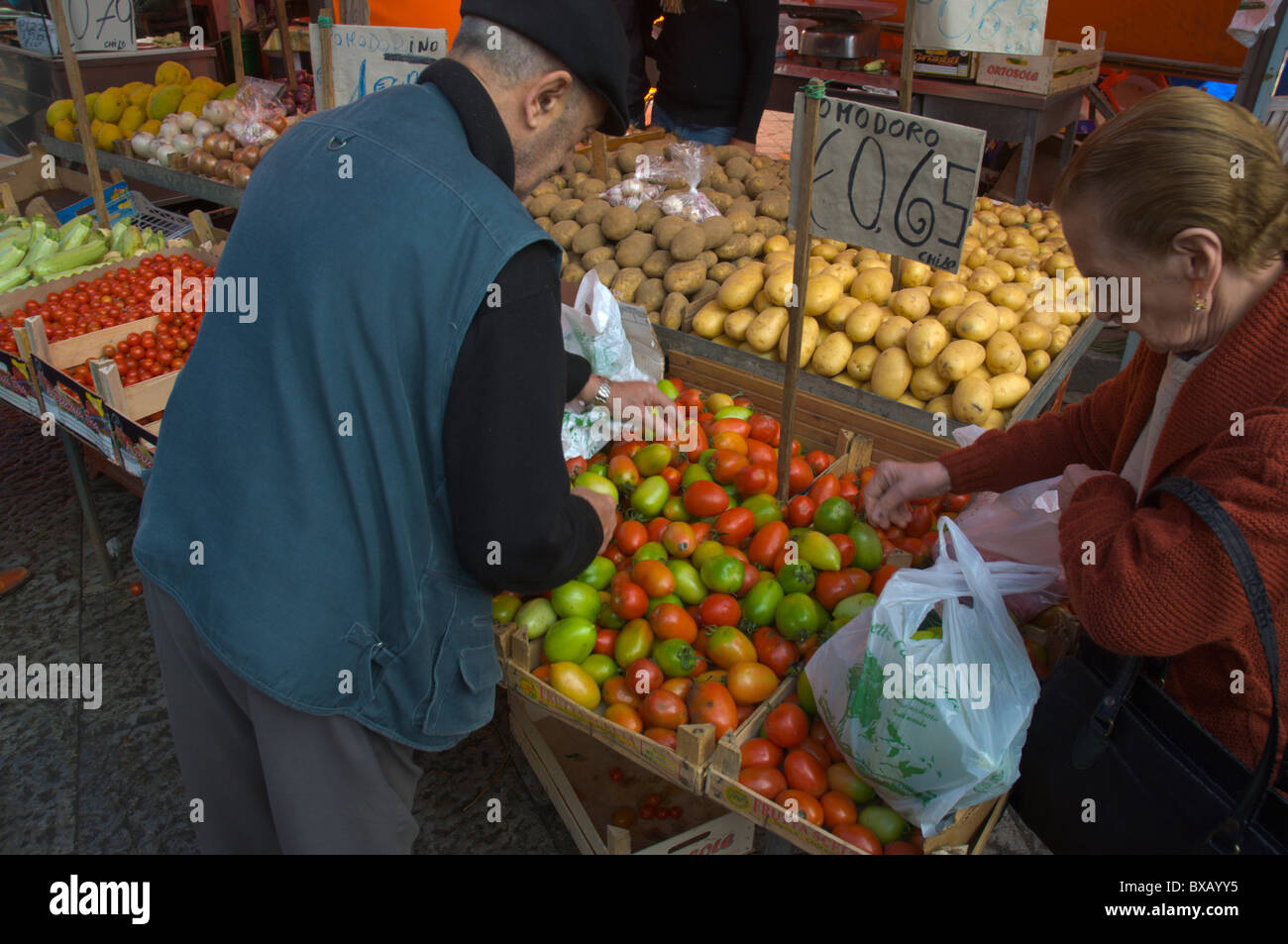 People selecting tomatoes Mercato di Ballaro market Albergheria district central Palermo Sicily Italy Europe - Stock Image