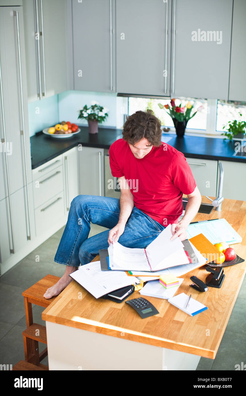 Mid adult man working from home - Stock Image