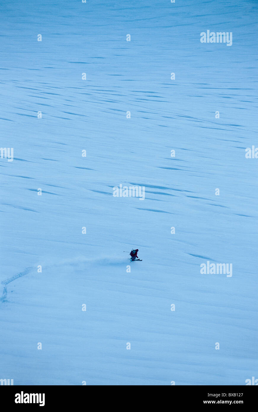 Distant view of tourist skiing - Stock Image