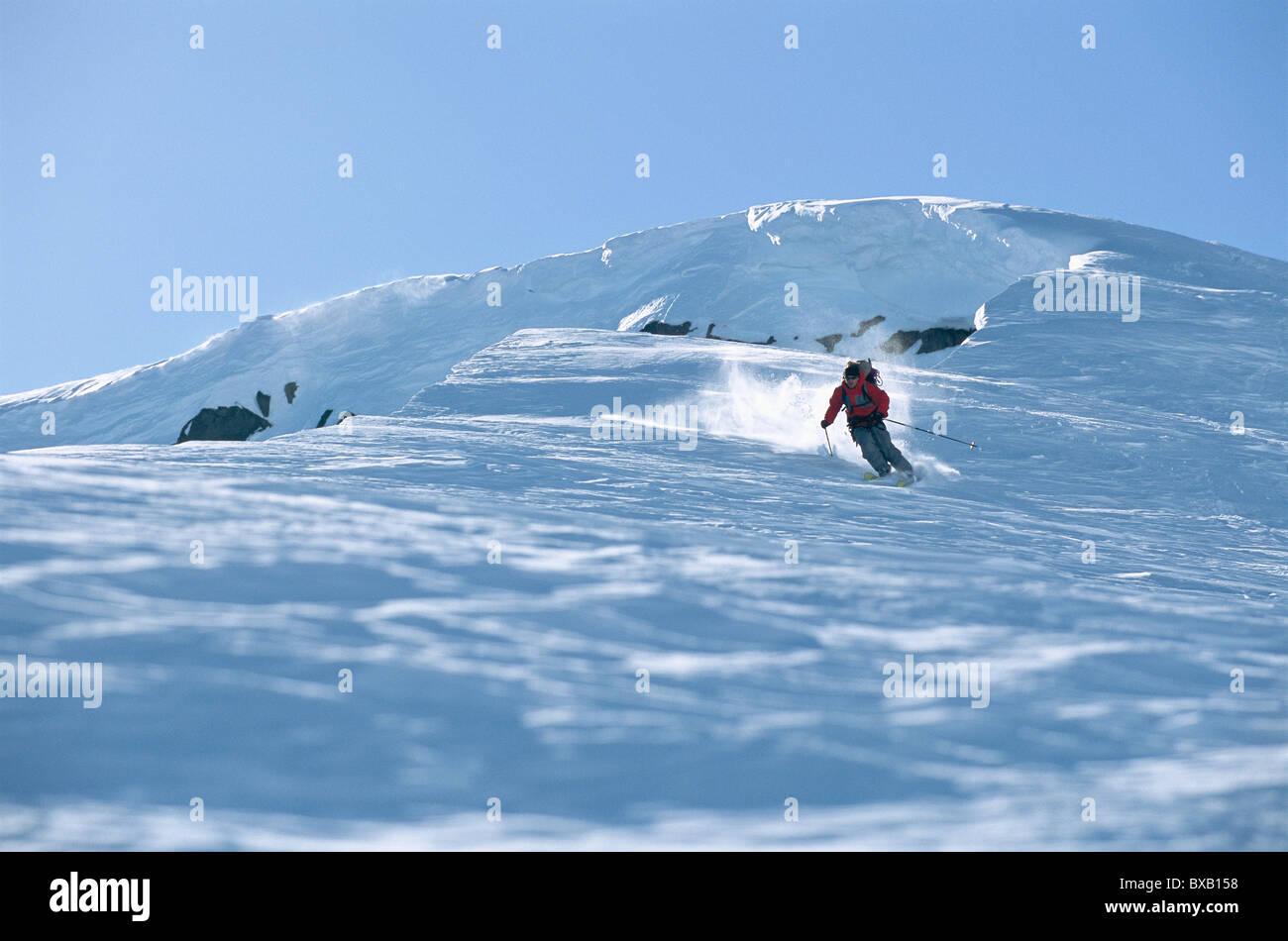 Tourist skiing Stock Photo