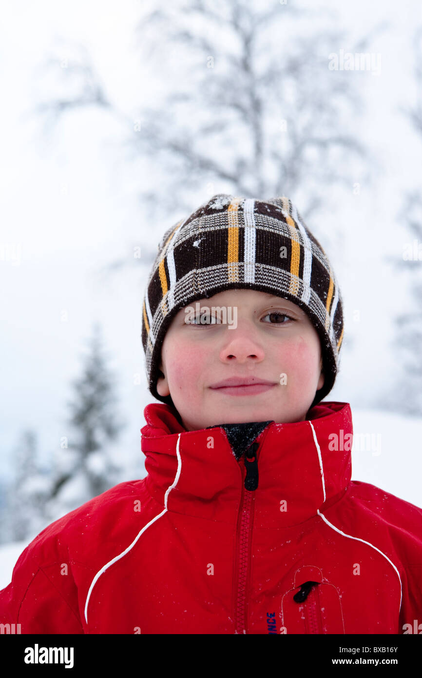 Boy playing on snow - Stock Image