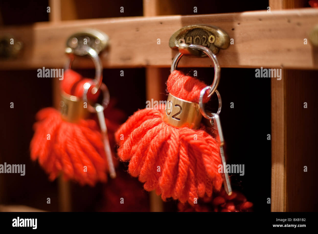 Key hooks at a hotel reception - Stock Image