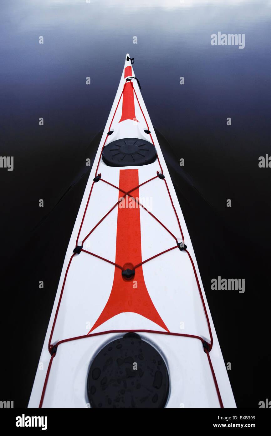 Kayak floating on water - Stock Image