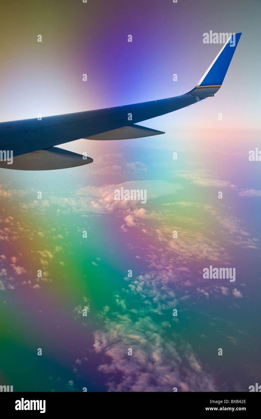 Wing of airplane in flight - Stock Image