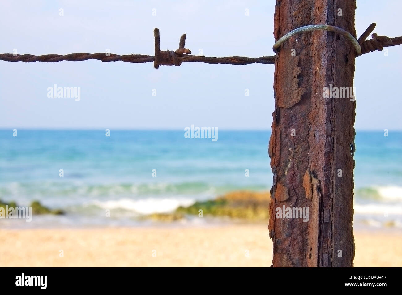 Wire fence blocking the beach, selective focus - Stock Image