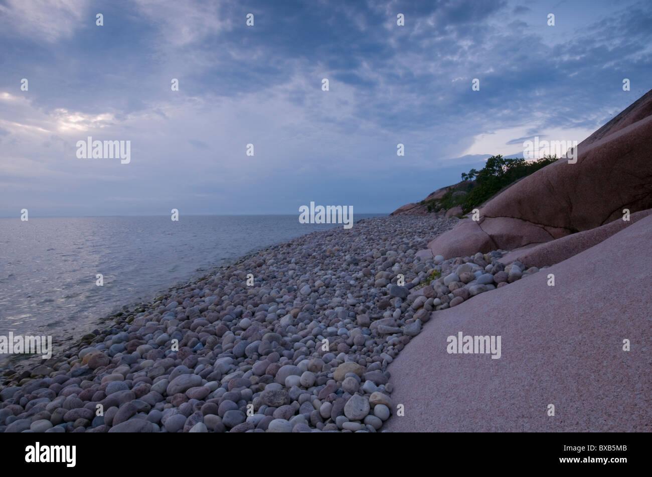 Pebbles on shore - Stock Image