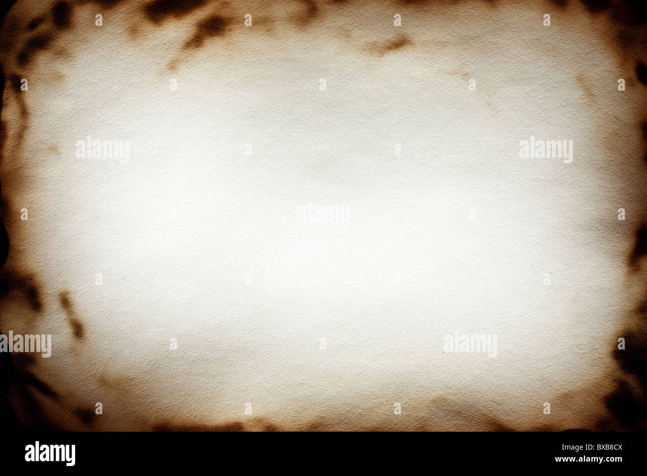 Burnt at the edges textured paper - Stock Image