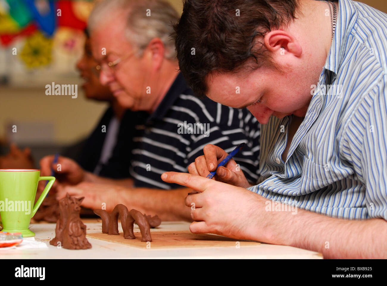 Men engaged in an art therapy programme, Nottingham, UK. - Stock Image