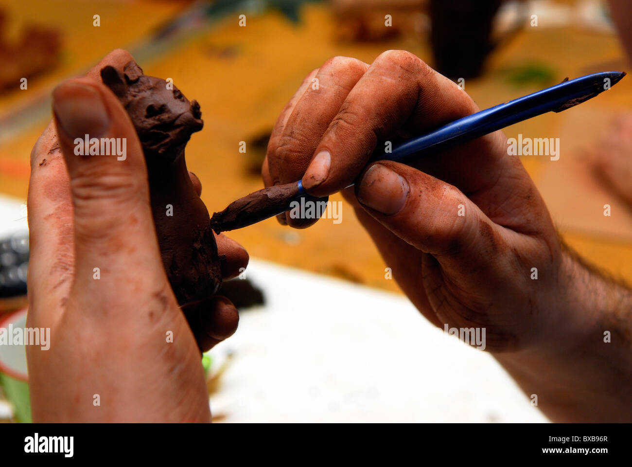 Man engaged in an art therapy programme, Nottingham, UK. - Stock Image