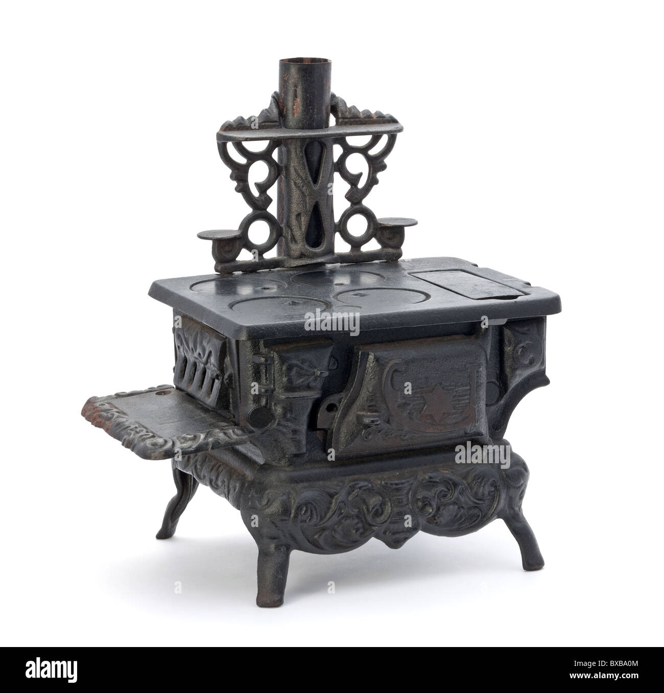 Old Miniature Stove isolated on a white background - Stock Image