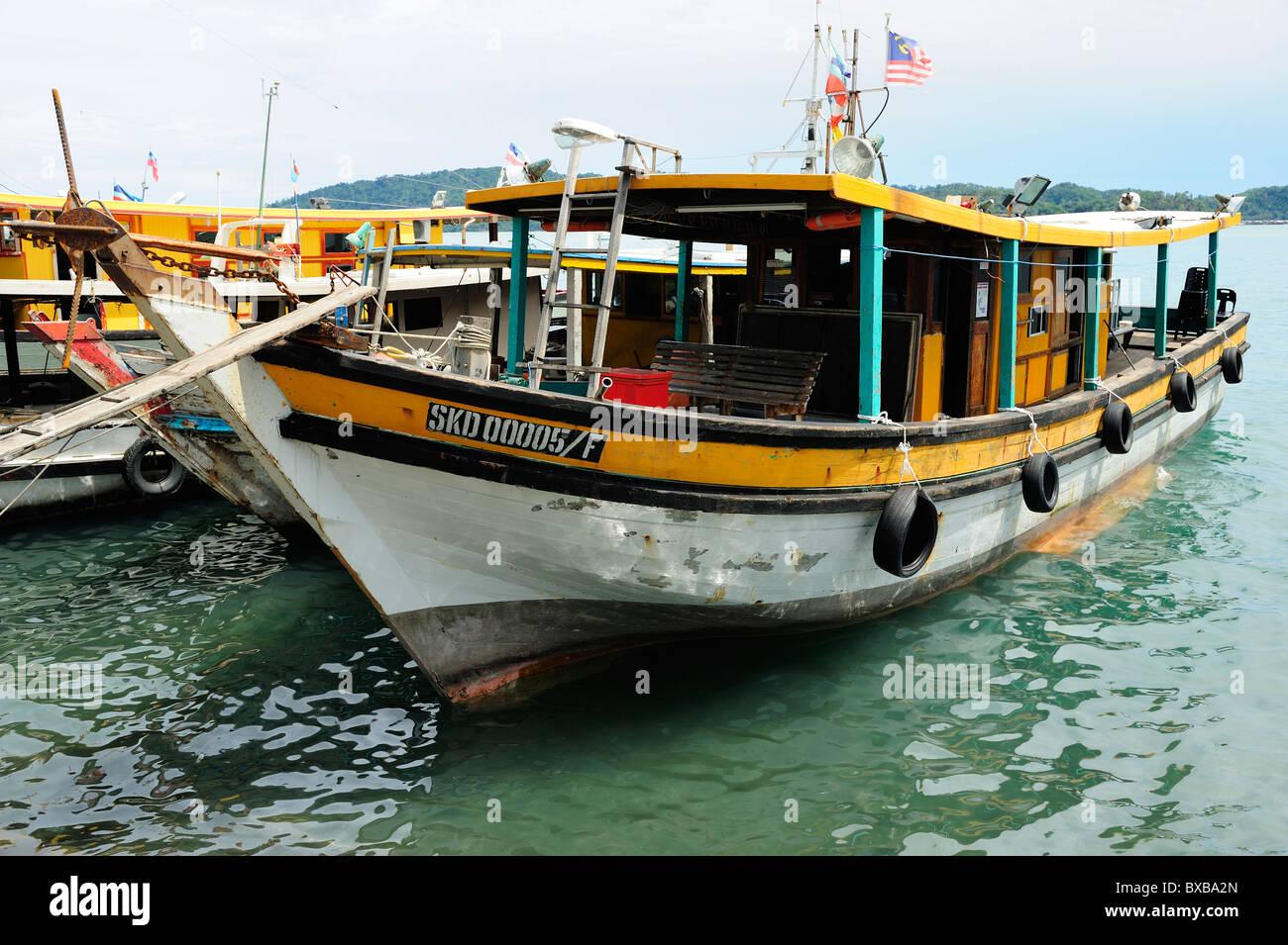 Fishing boat on waterfront in Kota Kinabalu, Sabah - Stock Image