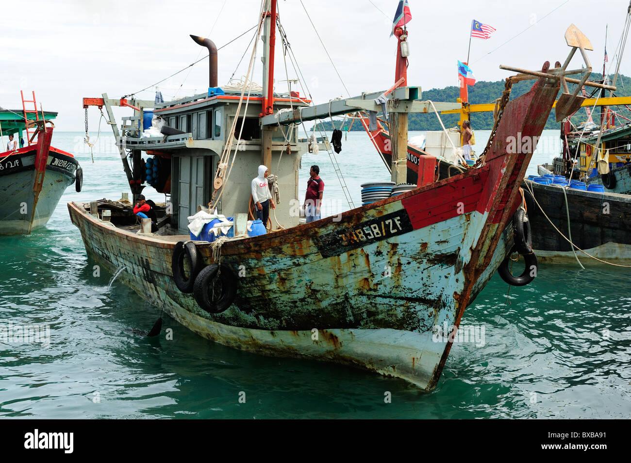 Fishing boats on waterfront in Kota Kinabalu, Sabah - Stock Image