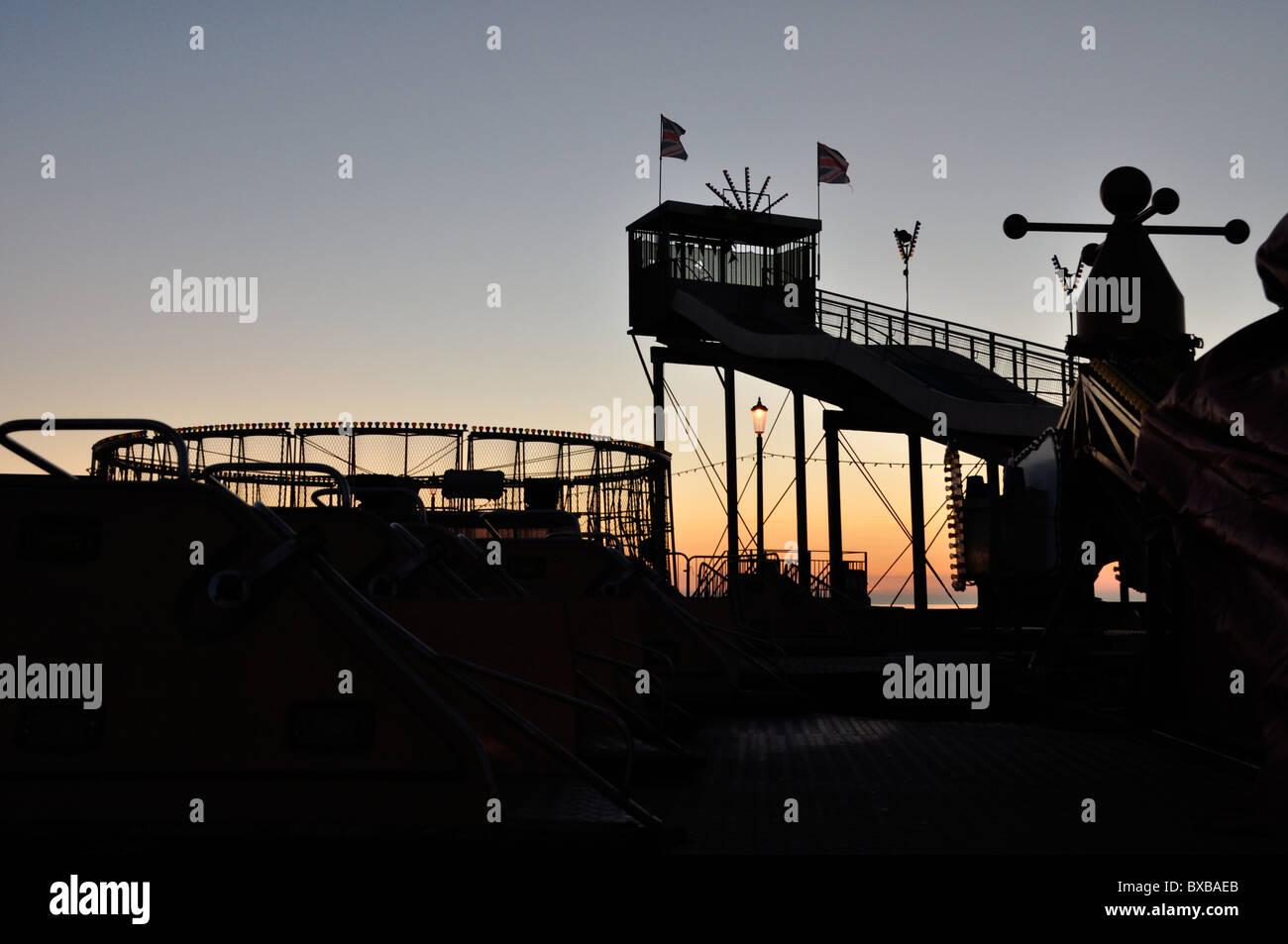 Deserted fairground rides in seaside resort - Stock Image