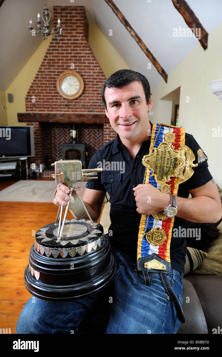 Boxing champion Joe Calzaghe at home near Blackwood, South Wales. Pictured with The World Super Middleweight Championship - Stock Image