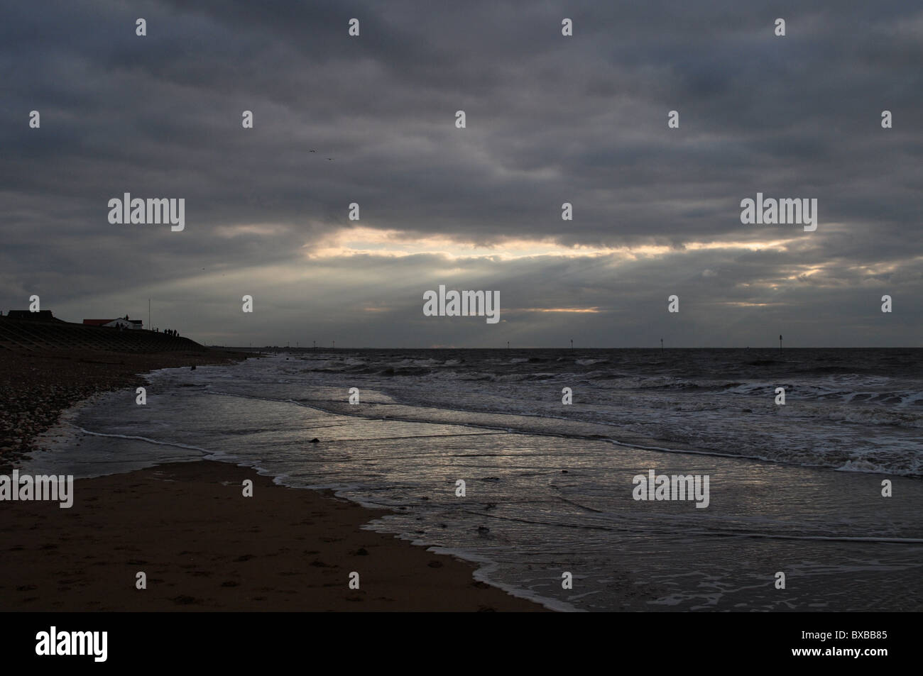 Stormy black skies, cloud gaps on The Wash - Stock Image
