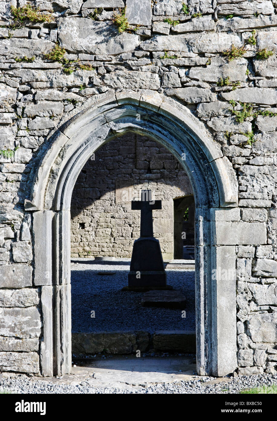 Arched Doorway To Corcomroe Abbey Framing A Gravestone In The Form Of A  Cross, The