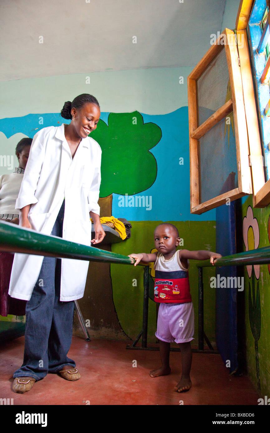 Child with developmental disorder at physical rehabilitation, Maji Mazuri Children's Centre, Nairobi, Kenya - Stock Image