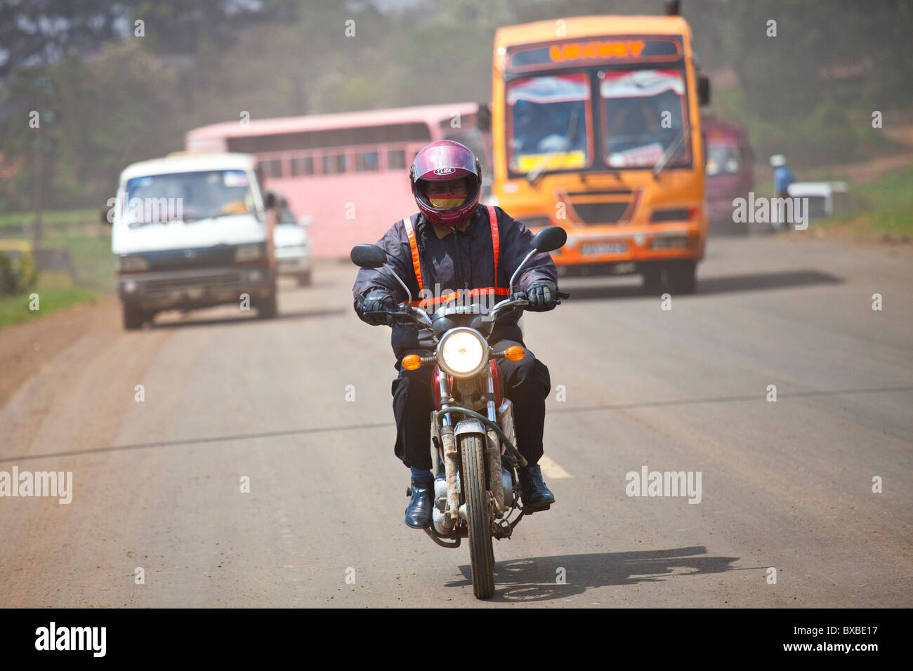 Motorcycle in traffic, Nairobi, Kenya - Stock Image