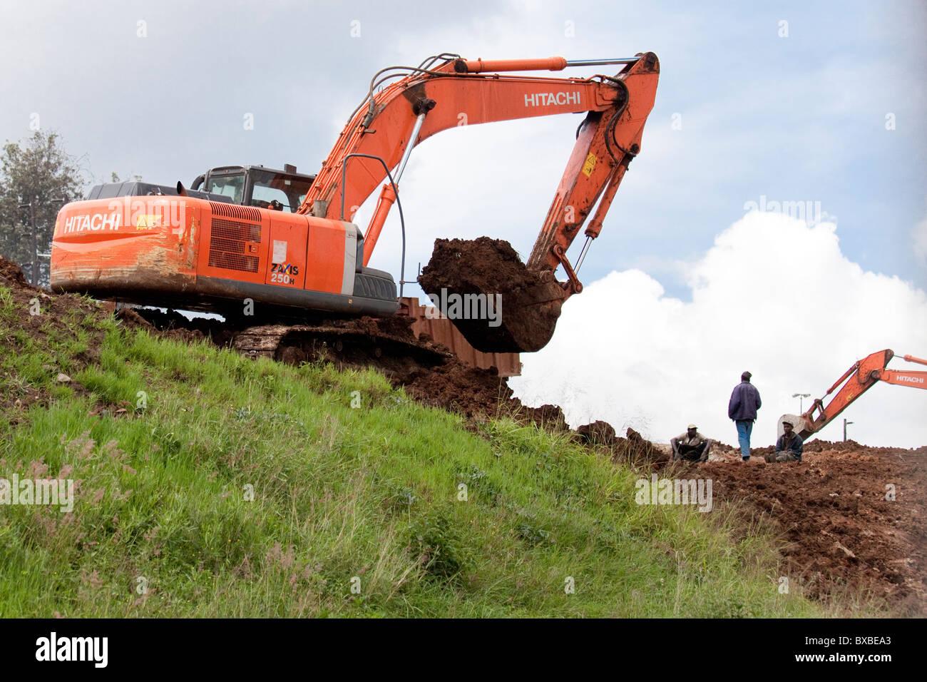 Excavator or digger heavy equipment working on highway construction in Nairobi, Kenya - Stock Image