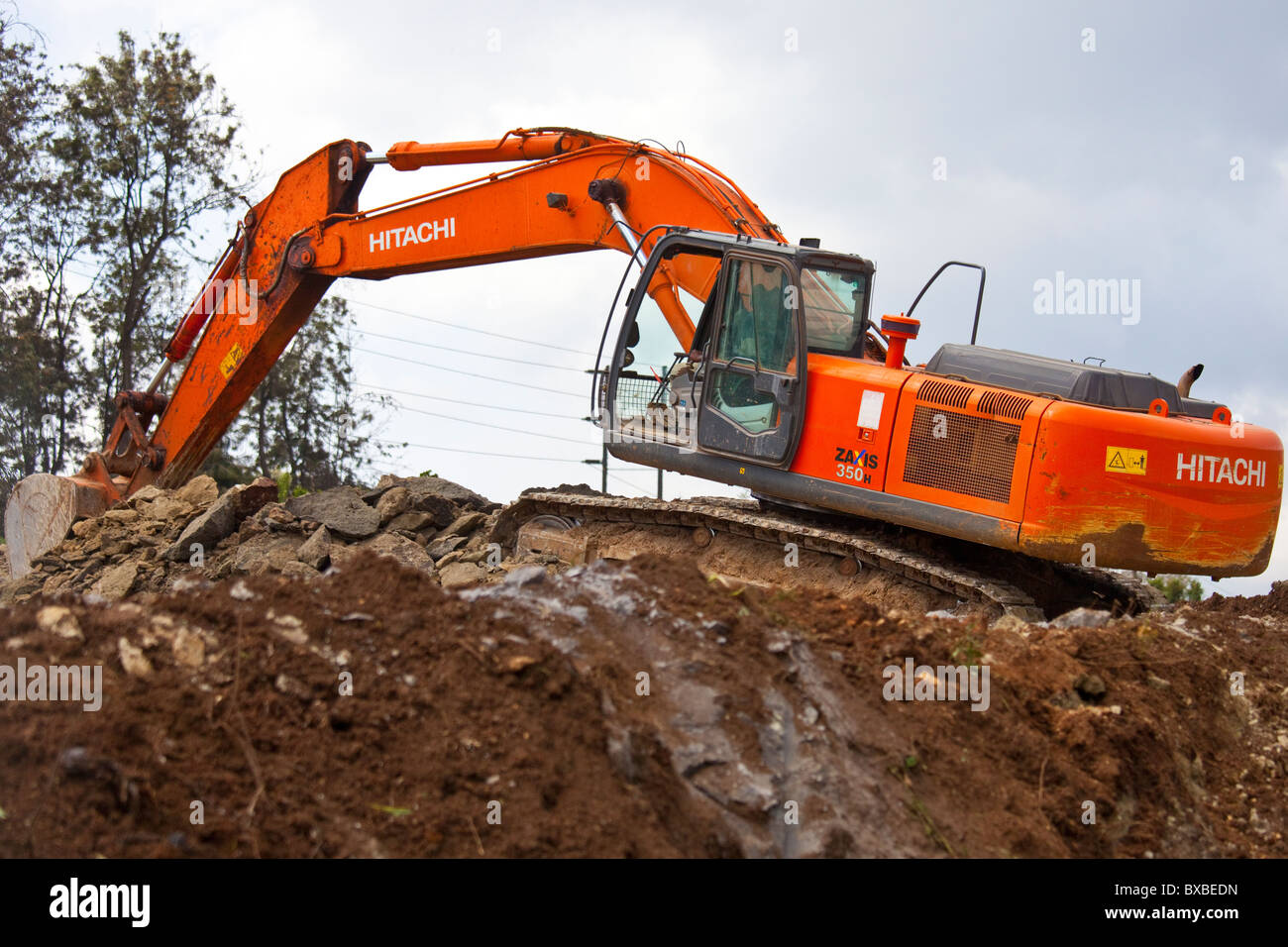 Excavator or digger heavy equipment working on highway construction in Nairobi, Kenya Stock Photo