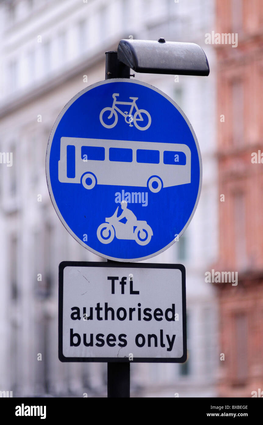 Bus, Cycle and Mororcycle lane roadsign, TFL authorised buses only sign, Cockspur Street, London, England, UK - Stock Image