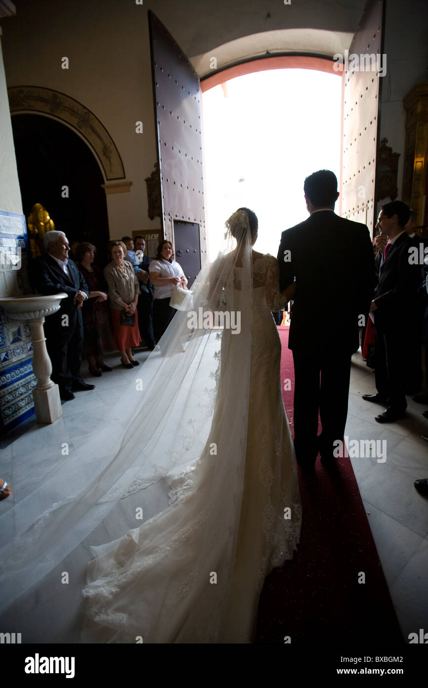 A newly wed couple leaving a church, Granada, Spain - Stock Image
