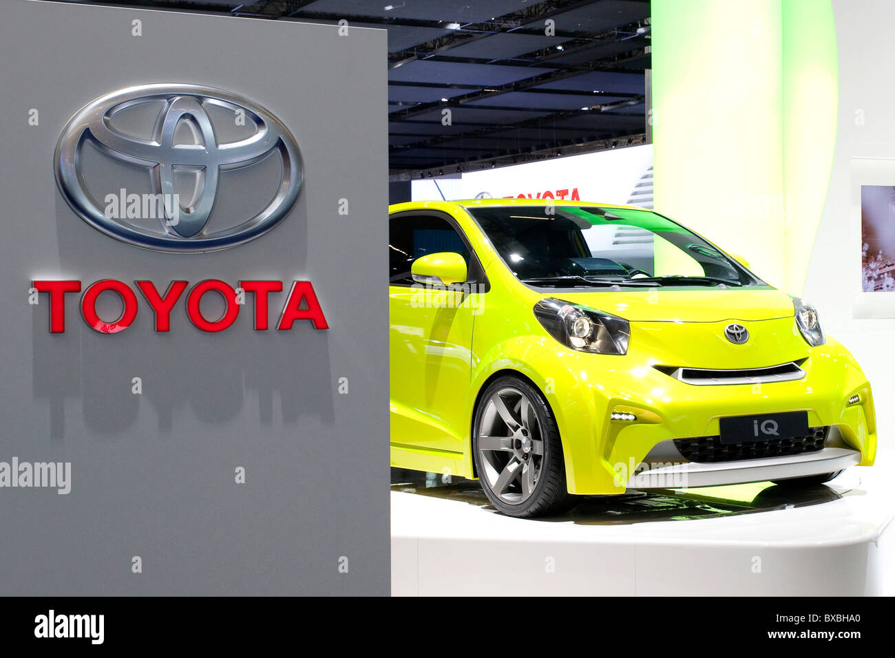 Logo of the Toyota auto maker with a IQ compact car at the 63. Internationale Automobilausstellung International - Stock Image