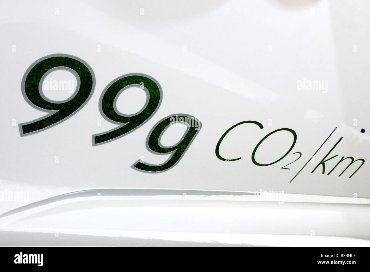 Lettering 99 grams of CO2 emissions on a vehicle at the 63. Internationale Automobilausstellung International Motor - Stock Image