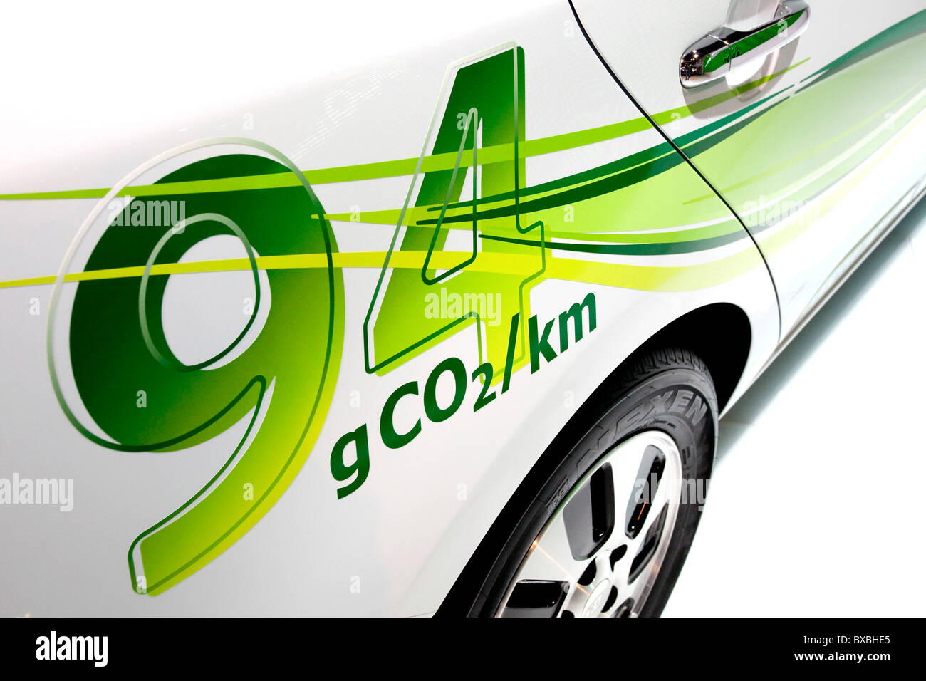 Lettering 94 grams of CO2 emissions on a Kia Motors vehicle at the 63. Internationale Automobilausstellung International - Stock Image