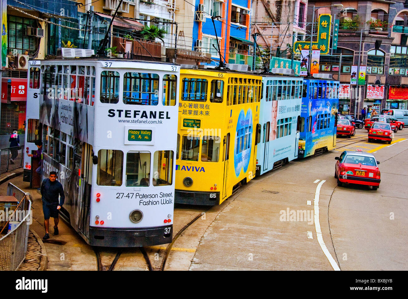 Line of double decker buses in row at bus stop in downtown Hong Kong China - Stock Image