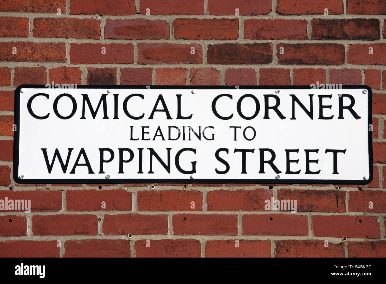 Amusing street sign Comical Corner Leading to Wapping Street, South Shields, Tyne and Wear, England, UK - Stock Image