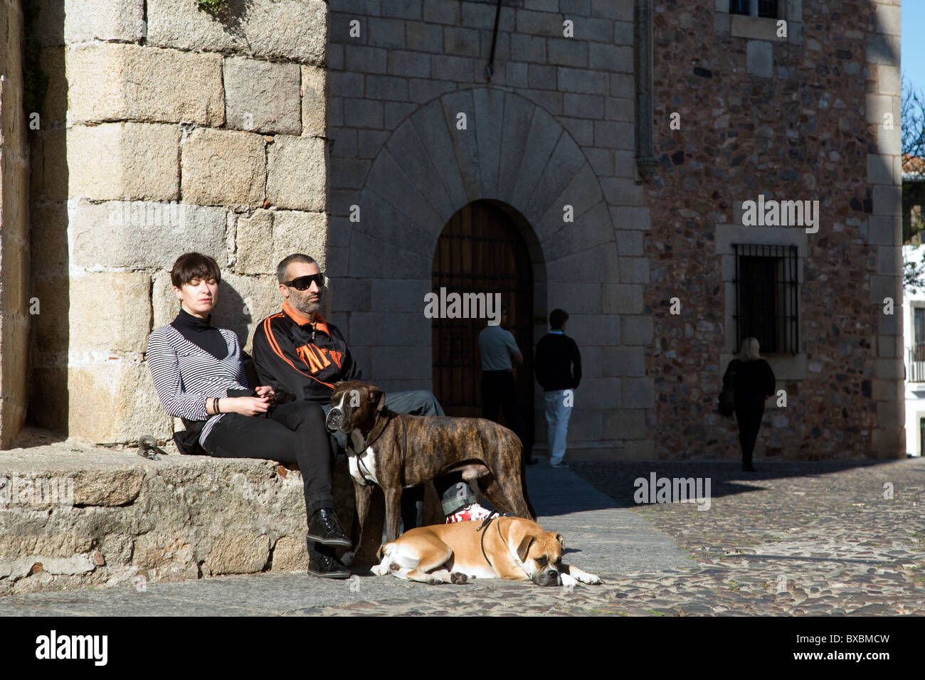 A couple with their dogs, Caceres, Spain - Stock Image