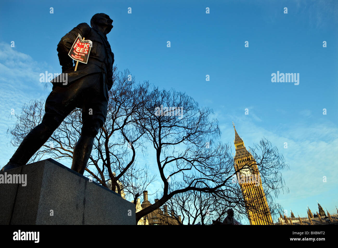 Socialist Worker tuition fee protest placard on the statue of Jan Christiaan Smuts in Parliament Square, London - Stock Image