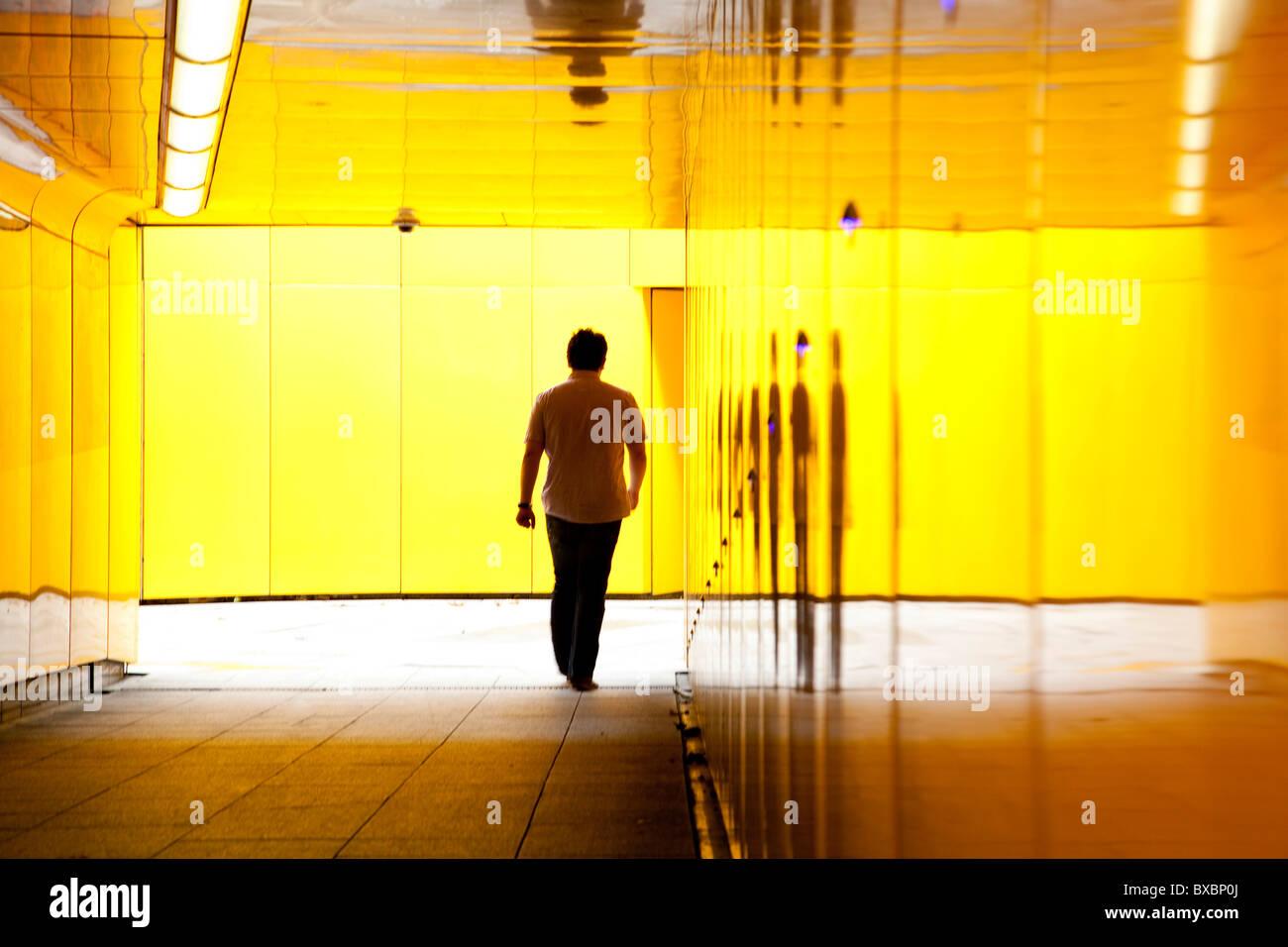 Man walking through an underpass in London, England, United Kingdom, Europe Stock Photo