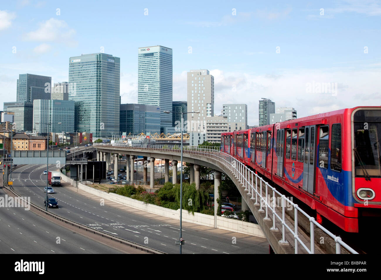 Financial district in Canary Wharf, commuters train DLR and the motorway in London, England, United Kingdom, Europe - Stock Image