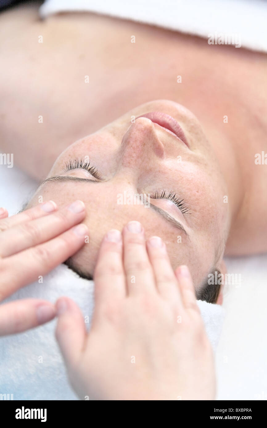 Woman during a facial massage Stock Photo