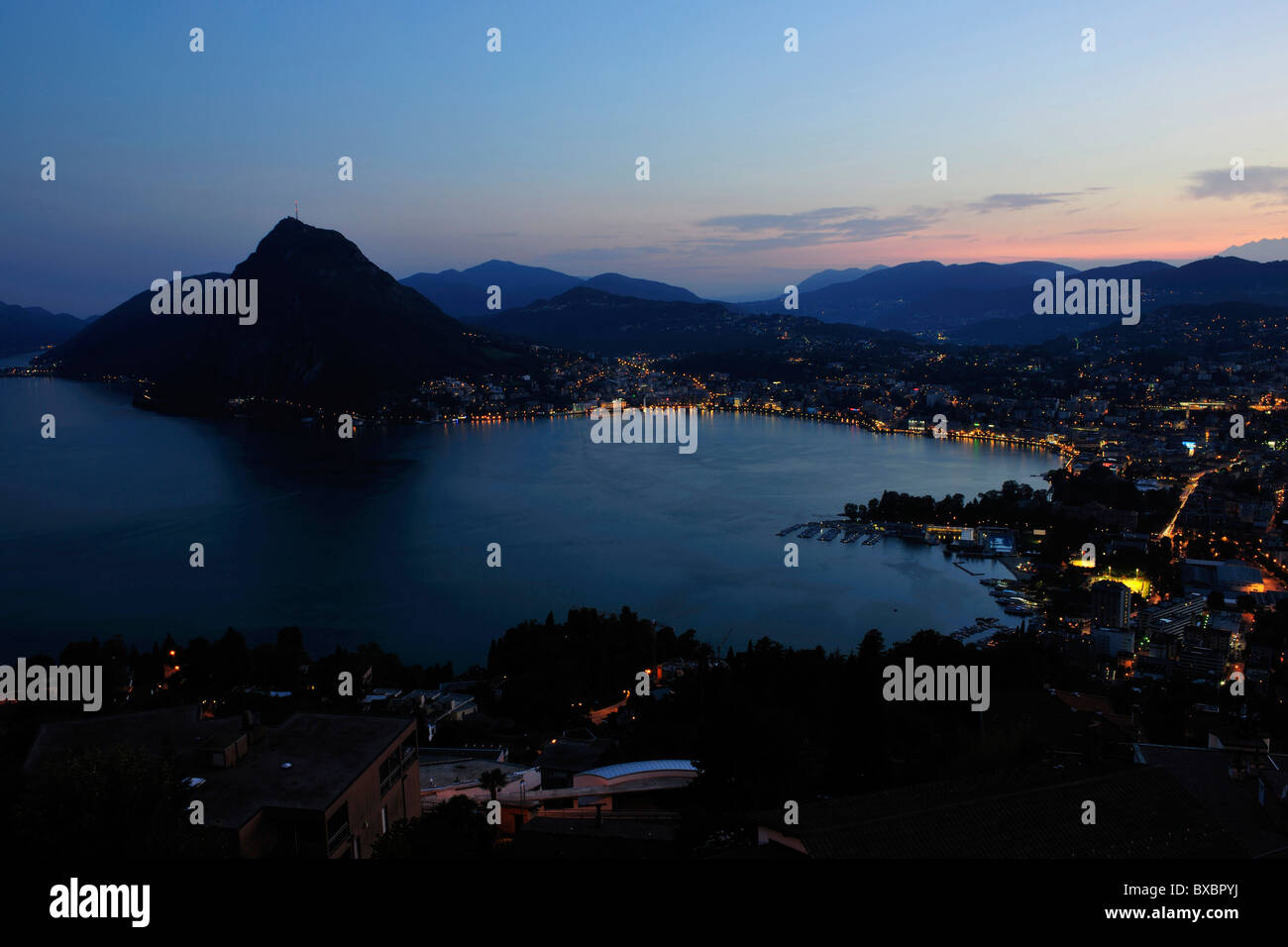 Lugano with San Salvatore mountain on Lago di Lugano, Lake Lugano, Canton of Ticino, Switzerland, Europe Stock Photo