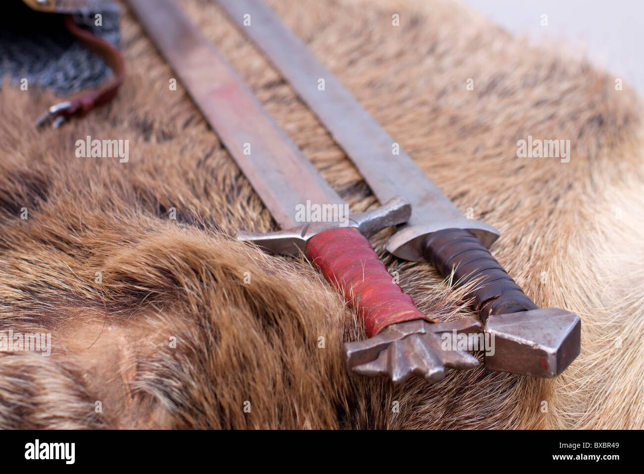 Two European medieval Slavic swords displayed on animal fur Stock Photo