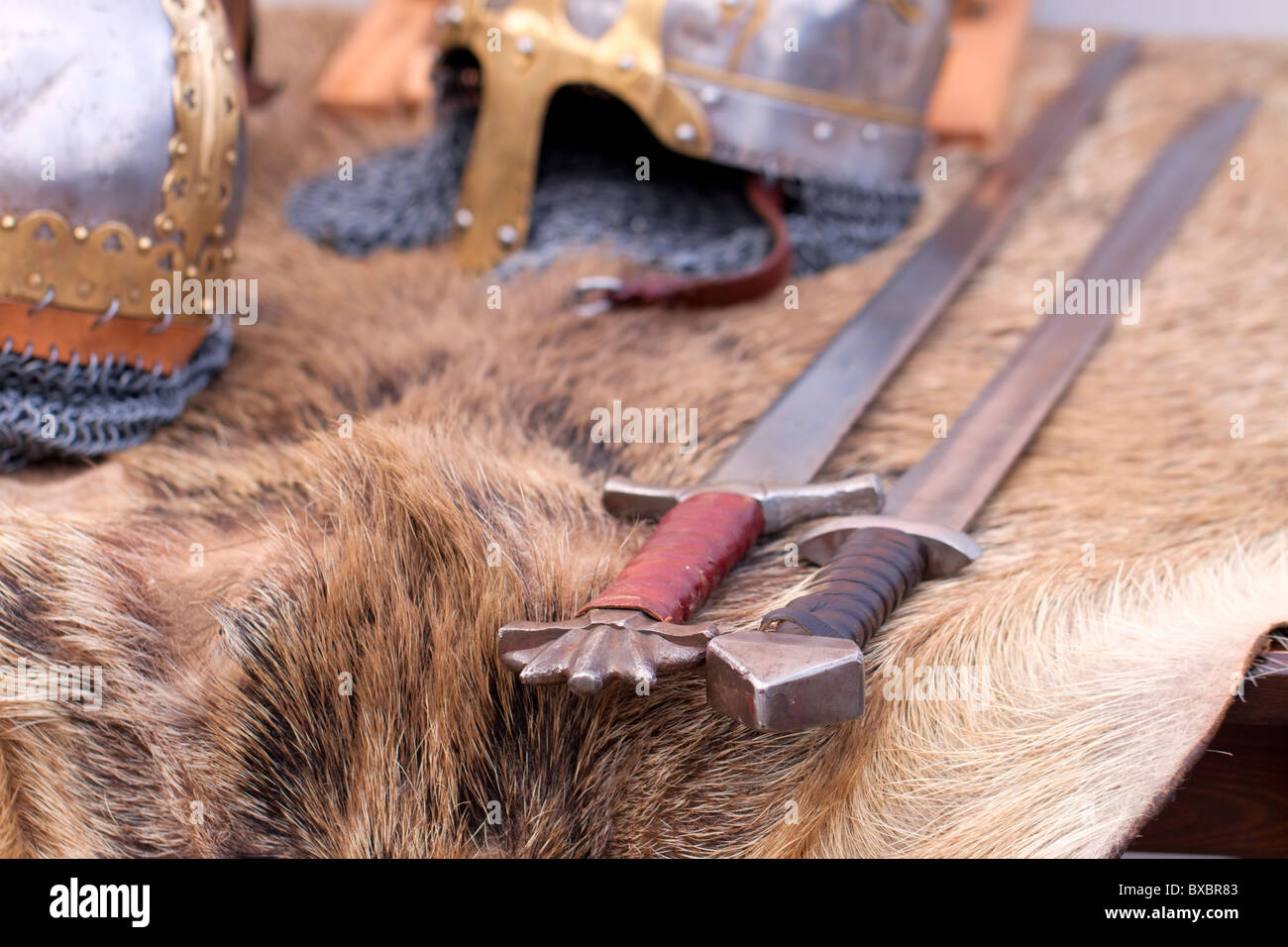 European medieval Slavic swords and helmets displayed on animal fur Stock Photo